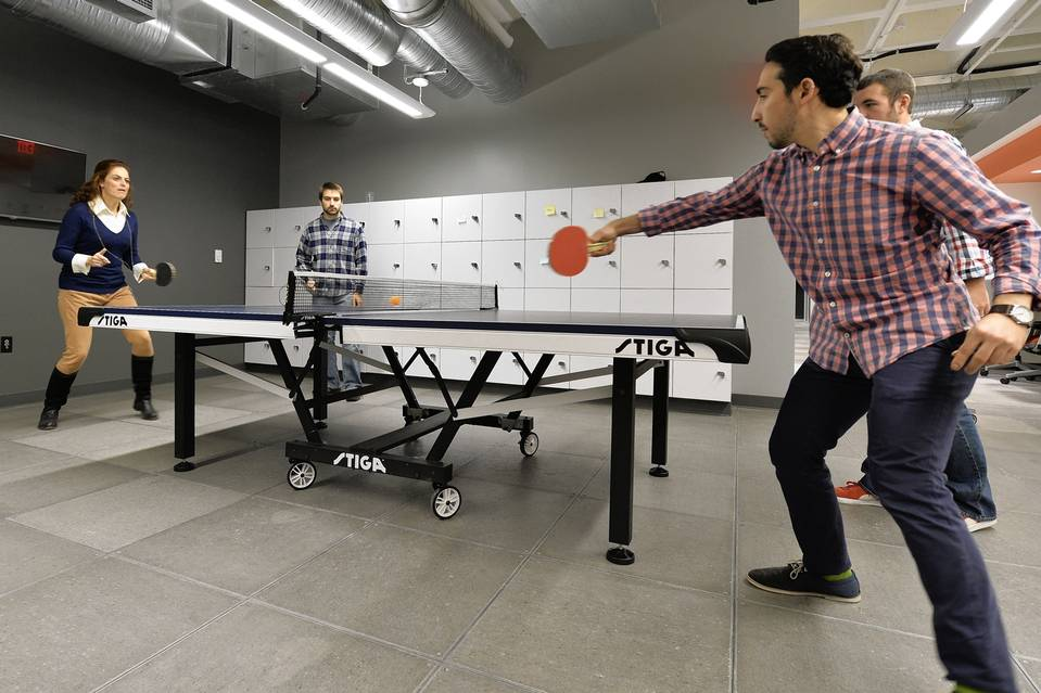 Humana employees playing ping pong