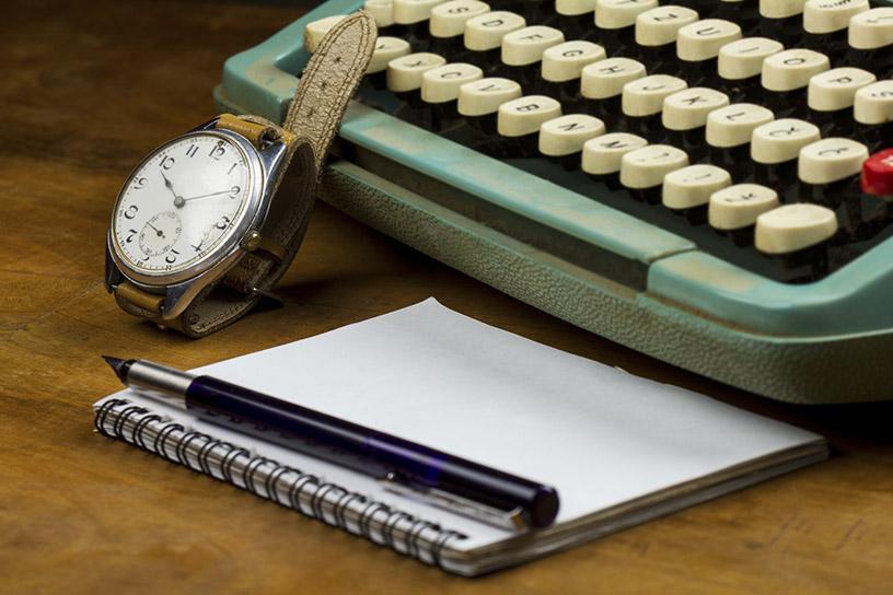 Watch, notepad, and typewriter
