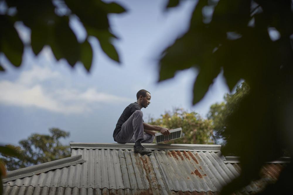 A man installing a solar panel